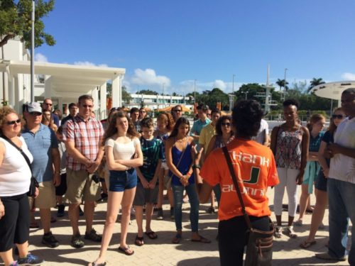College bound high school students and their parents take a campus tour at the University of Miami in Coral Gables, Fla.